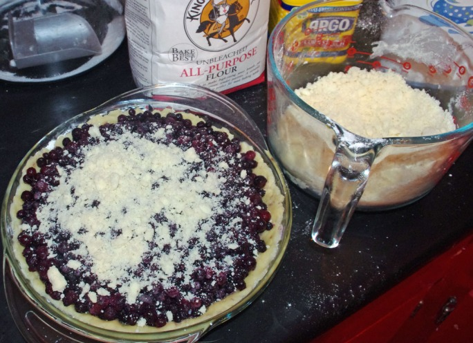 Then, sprinkle crumble crust over the berries, covering thoroughly.